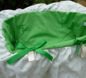 Lime green seat with green and white chevron pattern ruffle for baby girls. Coordinating drawstring tote bag.