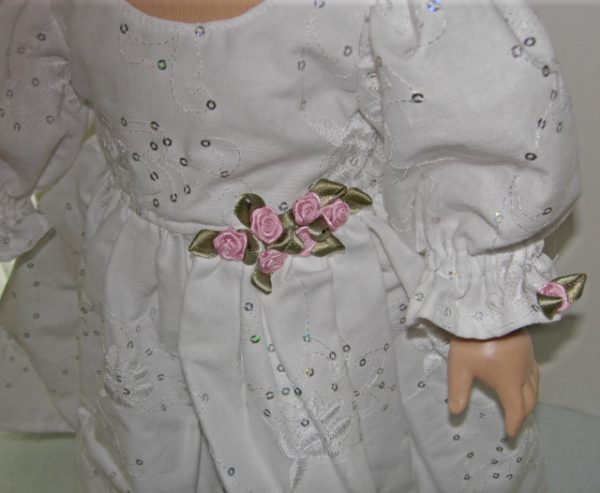 White dress with pink ribbon roses Fits 18 inch dolls such as American Girl dolls. A perfect party dress.
