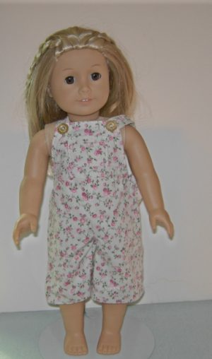 Short overhauls in beige with pink flowers for American Girl dolls